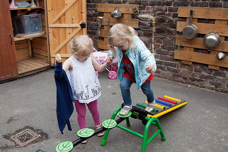 Two of our children enjoying garden play equipment