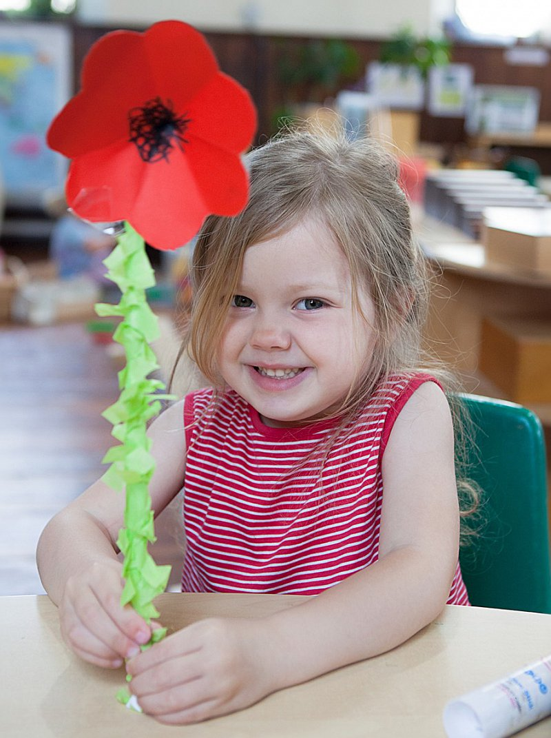 Happy child with big paper poppy!